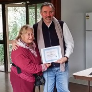 Karmel receiving the life membership certificate from Bill